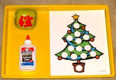 Montessori Christmas activities: Decorate the Christmas tree with pom poms || Gift of Curiosity