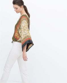 PRINTED KIMONO WITH FRINGING AND ZIP