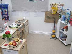 Inviting and well stocked home corner at KU Countess using real fruit and veg