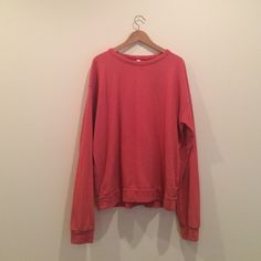 Oversized/relaxed fit coral sweatshirt. Basically brand new American Apparel sweatshirt...it might be for men's but I like the relaxed boyfriend look of it with tight skinny jeans. The color will give your whole style a pop! American Apparel Sweaters Crew & Scoop Necks