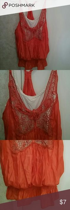 Top It's a shimmery orange 2 piece (as one) tank. Can be worn with jean, shorts or dressed up. Has adjustable straps with a rope neck line rue 21 Tops Tank Tops