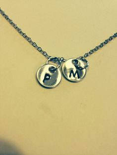 A personal favorite from my Etsy shop https://www.etsy.com/listing/189499597/hand-stamped-personalized-necklace-10mm