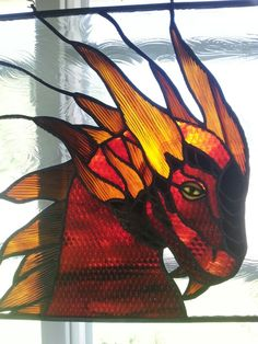 Stained glass Dragon.  Looks pensive!  Love him (her?)