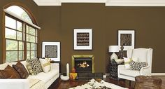 Dark Brown with a green undertone walls with white furnishings and decorative prints