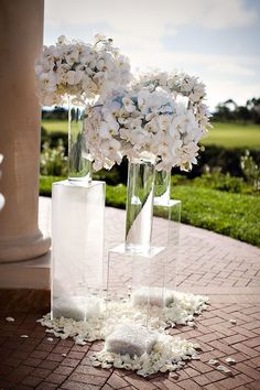 lucite risers with floral, wedding decor Elegant Centerpieces, Wedding Table Centerpieces, Wedding Flower Arrangements, Flower Centerpieces, Centerpiece Ideas, Tall Centerpiece, White Orchid Centerpiece, White Floral Arrangements, Elegant Wedding