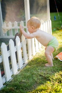 Cute baby but.... I like the mini white picket fence around the coop and I just do happen to have some!!!: