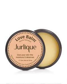 Love Balm - A natural salve that moisturizes, softens and protects dry or chapped skin. Infused with the natural scent of tangerine.
