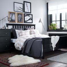 Use frames and textiles to show off some of your personality in the bedroom.