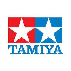 株式会社タミヤのロゴ:赤と青のツインスター | ロゴストック