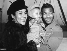 American boxer Sugar Ray Robinson poses on a pier with his wife Edna Mae, and son, Ray Jnr, after returning on the French liner 'Liberte' from a European tour. Sugar Ray Robinson, Prophets In Islam, American Boxer, Vintage Black Glamour, Black Celebrities, European Tour, Family Affair, Significant Other, African American Women