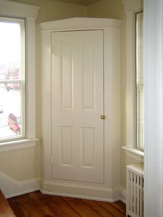 Corner linen closet in an upstairs hall creates extra storage space from an otherwise unused corner.