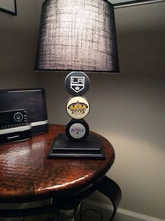 LA Kings Hockey Puck Lamp This would replace the NHL desk lamp you had as a child! Hockey Sticks, Hockey Puck, Hockey Mom, Hockey Stuff, Hockey Crafts, Hockey Decor, La Kings Hockey, Hockey Bedroom, Big Boy Bedrooms