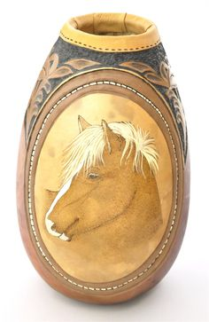 carved leather tooling and detailed pyrographed horse on gourd by Pamala Redhawk