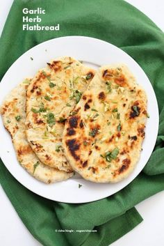 Garlic flatbread recipe No Yeast. This Easy garlic herb flatbread is Yeast-free, doesn't need hours to rest, & has a secret ingredient! (Aquafaba). Can be made into Garlic Naan. Vegan Recipe.