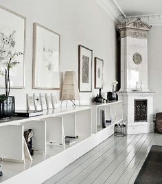 White wall, white floors and white fireplace