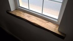 replace bedroom window sill with something more wood or richer in color