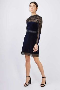 Tap into a luxe look with two trending textures this season. This dress comes in a deep blue velvet bodice with black lace sleeves and trim details throughout. In an figure flattering a-line fit, it is perfect for teaming with metallic finish heels and an oversized clutch. #Topshop