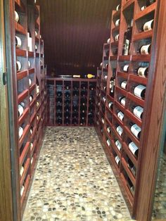 Making good use of that area under the stairway. Wine Cellar.