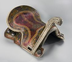 Saddle | Central Asia; Kokand | 1868 | wood, silver, bronze, semiprecious stones | Hermitage | Inventory #: В.О.-5213