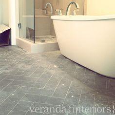 Herring bone tile floors in bathroom veranda interiors