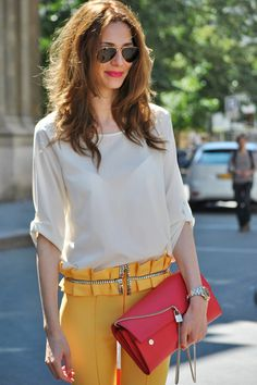 bright pants and clutch