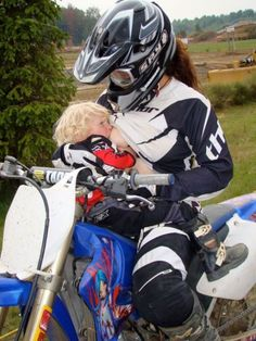 Motocross mama!... hahaha! This kid seems to big to still be doing this. But this would be me one day!