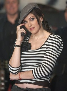 "Madonna went all acoustic and beatniky at the launch party for ""American Life"" in 2003; donning a beret and playing guitar for the first time on national TV...with her guitar teacher in tow, of course. Remember when she took requests from the audience and ended up botching the words to ""Like a Virgin?"""