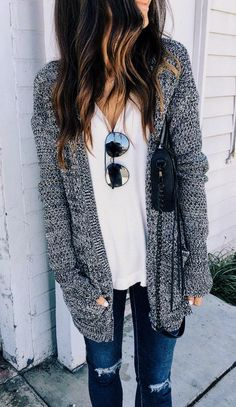 long gray knit sweater with a white tee                                                                                                                                                                                 More