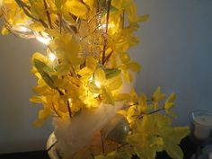 Lent/Easter - I wrapped the tree in white tulle as garland.  The gold ornaments are upcycled Christmas ornaments; as are the glass flowers that my mother bought from Princess House Crystal in the early 1980's.