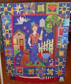 Quilts tell stories. I love the angel dog in this quilt!