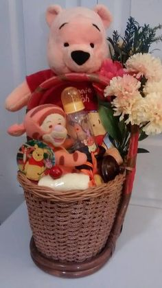 $55 BASKET *Brown Handle Basket *LG Winnie The Pooh Plush *Small Tigger Plush *9oz Winnie The Pooh & Friends Baby Bottle -Lays inside a honey pot *Pooh Waterproof Long Sleeve Self Eating Bib *Pooh Night Light *Small Yellow rolled hand towel *Faux ...
