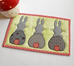 Bunny Hop Mug Rug pattern.  This cute little pattern includes three different designs.  This one is the Bunny Hop version.