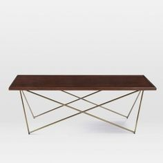 """This table is not only very useful, but it also brings a classic style into the house. Its size (48""""w x 20""""d x 16.8""""h) is good for different sizes of indoors. Its brass finished metal legs are very attractive and durable."""