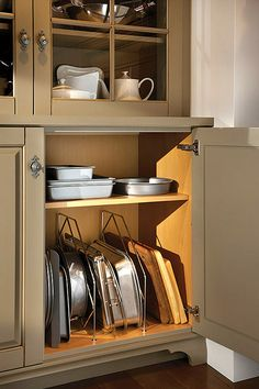 Wire dividers in Wood-Mode Fine Custom Cabinetry's units provide vertical storage for trays and platters.