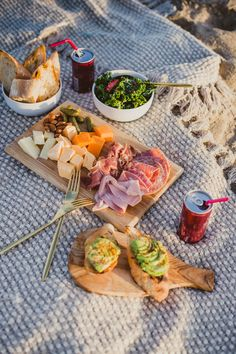 Click through to get tips on how to host the perfect Beach Date Picnic // Don't forget the cheese, meats, avocado toast, salad, fresh baguettes, and sparkling wine.