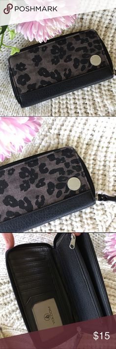 Volcom leopard wallet Brand new wallet from Volcom. It has black and gray loepard print. Zipper closure. Volcom Bags Wallets