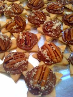 Cut stars out of ready-made pie crust, brush with melted butter and bake at 350 until golden brown. Remove from oven and put one Rolo per star. Put back in oven for a few minutes then place pecan half on Rolo and squash down. Top with Ritz cracker crumbs. Yummy!