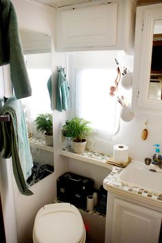 We put in some extra hangers for towels and those cute little pots from IKEA where we keep toothbrushes and toileteries.