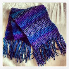Chunky knit crochet scarf with tassels.