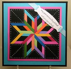 hand crafted quilt card  ... die cut quilt block ... black border squares  with white faux stitch lines ...  bright colored strips inside a pieced star ... luv the unique look ...