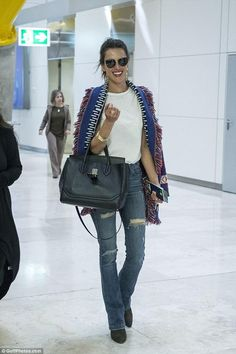 Alessandra Ambrosio wearing Hart Denim Nina High Rise Skinny Flare Jeans, Versace Palazzo Empire Bag, Linda Farrow 251 Sunglasses and Mate the Label One of a Kind Distressed Tee