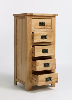 Our Western Oak living and dining range is hand built using high-grade oak.  Every piece within the Western Oak range is carefully made with dovetailed drawers and comes complete with solid oak drawer bases and cabinet backs. The Western Oak range has classically-styled metal handles, which offset the light oak timbers beautifully.