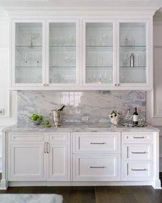 Butler's pantry boasts white inset cabinets topped with a gray and blue marble countertop fixed against a gray and blue marble slab backsplash beneath glass front cabinets. Glass Kitchen Cabinets, Inset Cabinets, Glass Front Cabinets, Built In Cabinets, Kitchen Redo, New Kitchen, Kitchen Storage, Kitchen Remodel, Kitchen Design