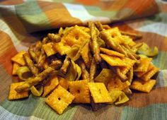 There's sure to be something for everyone in this snack mix. From cheesy crackers to cheese filled crackers, this seasoned up mix will please everyone. This makes a HUGE batch, too. Ranch Snack Mix Recipe, Party Mix Recipe, Snack Mix Recipes, Yummy Snacks, Healthy Snacks, Cooking Recipes, Yummy Food, Snack Mixes, Savory Snacks