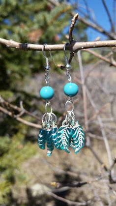 Check out this item in my Etsy shop https://www.etsy.com/listing/227175940/blue-feather-bead-earrings
