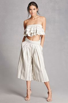 A striped two-piece set featuring a smocked tube top with tiered ruffles and a matching pair of culottes with a partially elasticized smock back, concealed side zip closure, and on-seam slip pockets.  This is an independent brand and not a Forever 21 branded item.