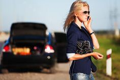 Fashion woman in sunglasses calling on mobile phone next to broken car Stock…