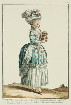 Galerie des Modes, 16e Cahier, 5e Figure  Young Lady in a Polonaise of indienne, trimmed with gauze, and coiffed with an English hat trimmed with flowers and a black lace.  She holds a bichon under her arm. (1778)