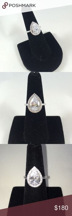 Adriana orsini pear shaped engagement ring size 6 Brand new beautiful Adriana orsini engagement ring purchased from Saks fifth. Has a beautiful pear shaped stone with stones around for the perfect bling! An eye catcher! adriana orsini Jewelry Rings