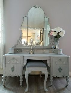 Chic and Shabby Furniture By Rebecca. This unique vintage 1881 vanity has 4 lined drawers and 2 doors. I did this is a mix of gray, silver, dark wax and added some vintage feel knobs. I was also able to get a vanity chair, reupolster and add vintage casters. I absolutely love this one! #darkshabbychicfurniture #VanityChair